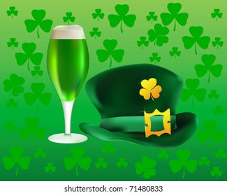 hat and a glass of green beer on a background leaf clover