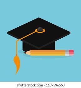 hat graduation and pencil