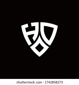 HD monogram logo with modern shield style design template isolated on black background