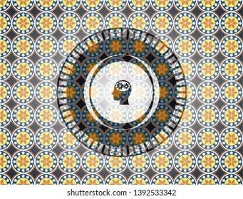 head with gears inside icon inside arabesque badge. arabic decoration.