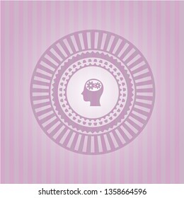 head with gears inside icon inside badge with pink background