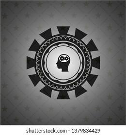 head with gears inside icon inside black badge