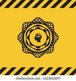head with gears inside icon black grunge emblem with yellow background. Vector Illustration. Detailed.