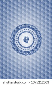 head with gears inside icon inside blue emblem with geometric pattern.
