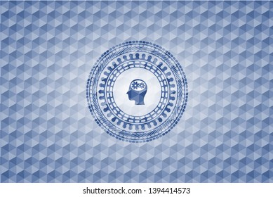 head with gears inside icon inside blue emblem or badge with geometric pattern background.