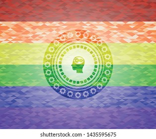 head with gears inside icon inside emblem on mosaic background with the colors of the LGBT flag