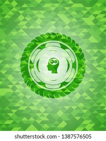 head with gears inside icon inside green emblem with mosaic background