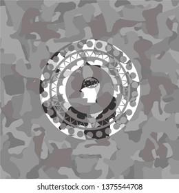 head with gears inside icon inside grey camo emblem
