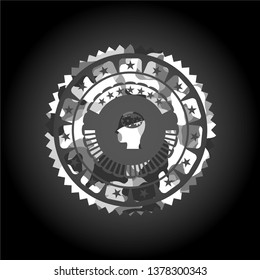 head with gears inside icon inside grey camouflage texture