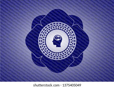 head with gears inside icon inside jean or denim emblem or badge background