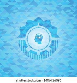 head with gears inside icon inside light blue emblem. Mosaic background