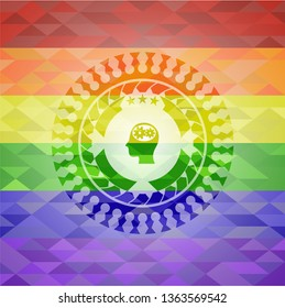 head with gears inside icon on mosaic background with the colors of the LGBT flag