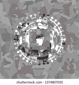 head with gears inside icon on grey camouflaged pattern