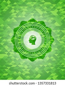 head with gears inside icon inside realistic green mosaic emblem