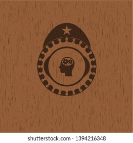 head with gears inside icon inside retro style wooden emblem
