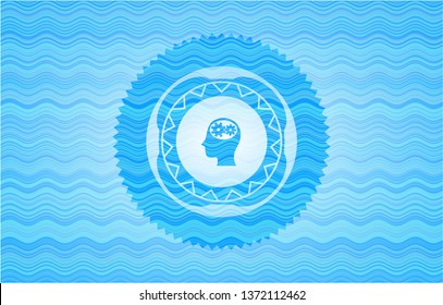 head with gears inside icon inside water wave representation style badge.