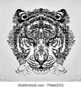 The head of a tiger in vegetal ornamentation