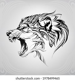 The head of a wolf in a floral ornament