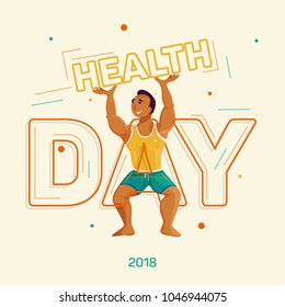 Health day. Sporty man in t-shirt and shorts holding the word health.