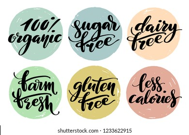 Healthy food label set. Product labels or stickers. Free from gluten, dairy and sugar food label set. 100 percent organic, farm fresh, less calories words by brush on circle backgrounds.