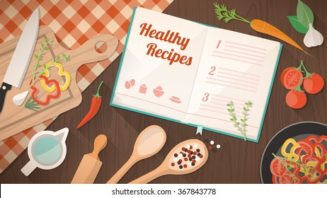 Healthy recipes cookbook, kitchen utensils and ingredients on the kitchen table, food preparation and learning concept