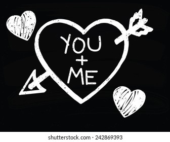 Heart with an Arrow Saying 'You and Me' on a Chalkboard background