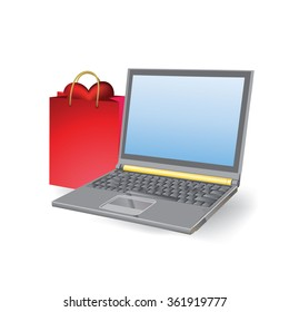 heart in the bag next to a laptop