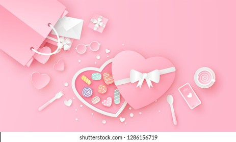 Heart chocolate box decorated in pink set on top view table with heart, gift box, envelope, coffee cup, shopping bag, glasses and smartphone. paper cut and craft style. vector, illustration.