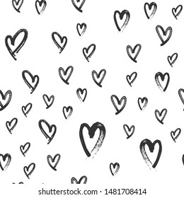Heart doodles seamless love pattern. Hand drawn brushed hearts. Background texture for valentine's day.