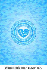 heart with electrocardiogram icon inside realistic light blue mosaic emblem