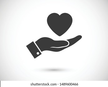 Heart in hand, a symbol of love. Vector illustration EPS10. Real estate concept