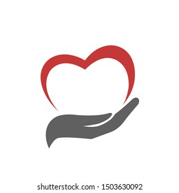 Heart in hand vector icon. Illustration of hand holding heart isolated on white background. Medicine icon. Symbol of kindness and charity. Vector web design