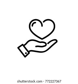 heart on hand icon vector