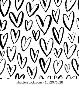 Heart seamless pattern. Black and white ink brush hearts hand drawn ornament. Romantic figures vector illustration. Monochrome freehand dry paint brush stroke shapes. Decorative textile, wallpaper
