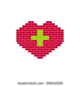 Heart Shape created from building bricks. Red shape with green cross. Sign for medicine, healthcare,  Charitable Foundation.