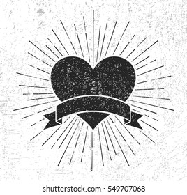 Heart symbol with sunburst and scroll on grunge background