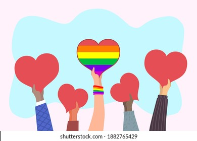 Hearts in hands. Hand holding big heart with rainbow LGBT flag. Demonstration in support of LGBT rights. Gay parade, Pride Day for LGBT community. Love has no limits. Homosexual and LGBT concept.