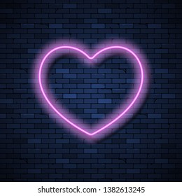Heart-shaped glowing neon frame on brick wall background