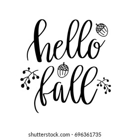 Hello Fall lettering text with autumn leaves and acorns. Hand drawn vector illustration. Black and white poster design elements.