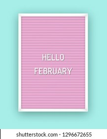 Hello February motivation quote on pink letterboard with white plastic letters