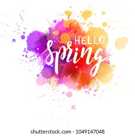 Hello Spring hand lettering phrase on watercolor imitation color splash. Modern calligraphy inspirational quote. Vector illustration.