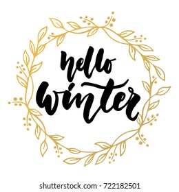 Hello, winter - hand drawn lettering quote with golden wreath isolated on the white background. Fun brush ink inscription for greeting card or t-shirt print, poster design