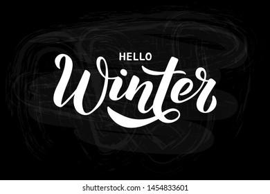 Hello Winter - Hand written lettering phrase on black chalkboard. Modern brushpen calligraphy. Vector illustration EPS10 for postcard, banner, poster, invitation, t-shirt and prints.
