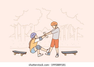 Helping hand and friendship concept. Small boy cartoon character helping his friend girl to get up after falling from scooter during walk outdoors vector illustration
