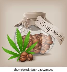 Hemp seeds n a glass jar with hemp leaf.