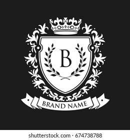 Heraldisches Emblem Schild mit Kronen- und Lorbeerkranz. Coat Arms Vintage Brand Crest Heraldic Emblem Shield. Vektorgrafik