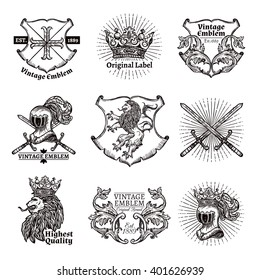 Heraldic grayscale isolated emblems set with crowns shields lions and swords in medieval style  vector illustration