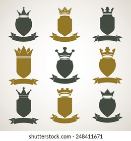 Heraldic royal blazon illustrations set, imperial striped decorative coat of arms. Collection of vector shields with king crown and stylish ribbon. Majestic element, graphic and web design.