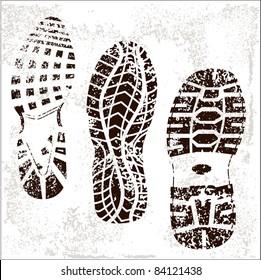A high detailed set of three grunge shoe tracks