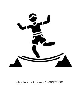 Highlining glyph icon. Slacklining. Walking and balancing on tightrope. Slackliner in mountains. Extreme sport stunt. Walker on rope. Silhouette symbol. Negative space. Vector isolated illustration